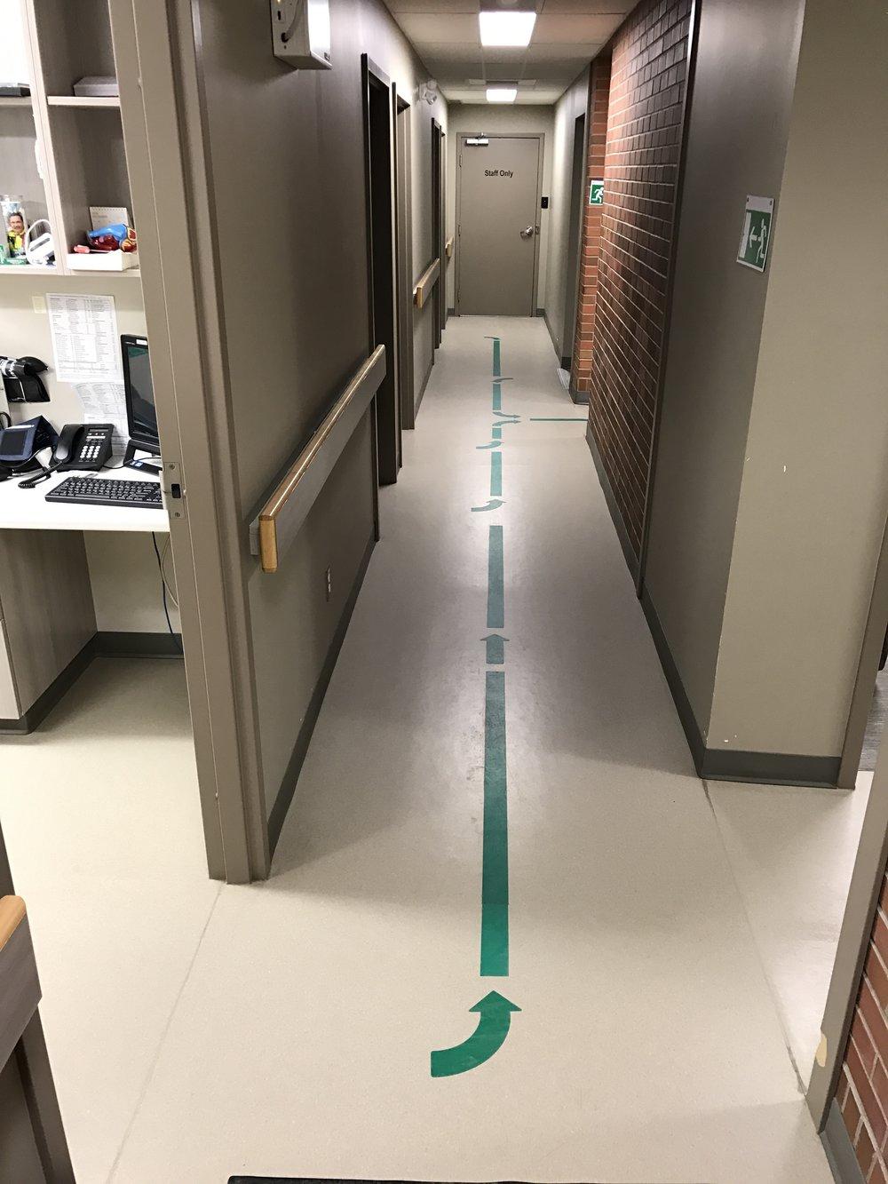 Medical racetrack clinic exit arrows
