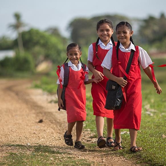 Kids walking to school in Ohonua, 'Eua.