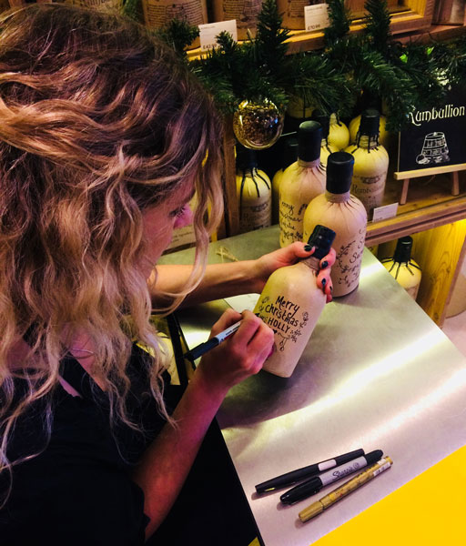 The talented May von Millingen making a bottle of Bathtub Gin even more snazzy!