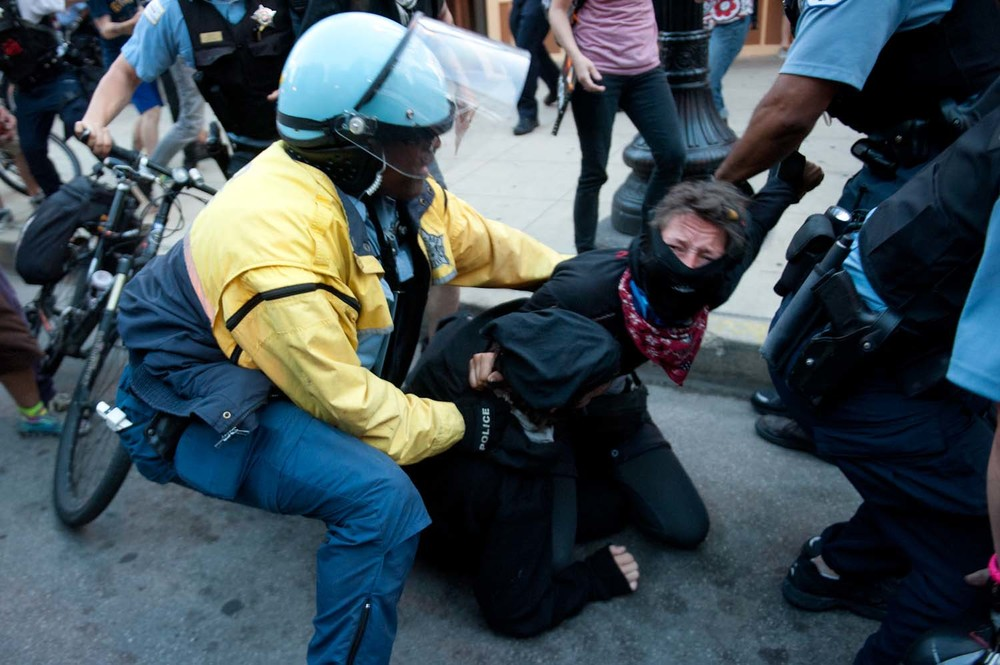 Two demonstrators are arrested after a scuffle with bicycle police during the 2012 Occupy NATO demonstrations in Chicago, IL. Demonstrators responded by throwing a police bicycle into the Chicago River. (May 19th, 2012)