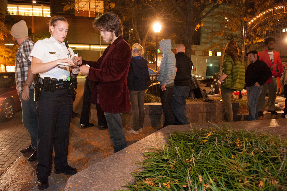 Activists line up in an orderly fashion to receive citations from the Cincinnati Police Department for being in Piatt Park after hours. The CPD hosted by far the most civil interaction between police and Occupy activists in the author's personal experience.