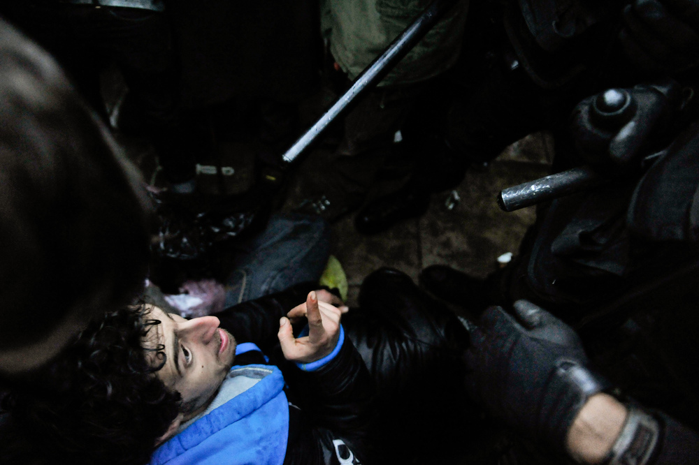 'Moe', after being shoved to the ground by the US Park Police, verbally confronts and ridicules their methodology of violence as a riot line develops during the eviction of Occupy K. St from McPherson Square. (February 4th, 2012)