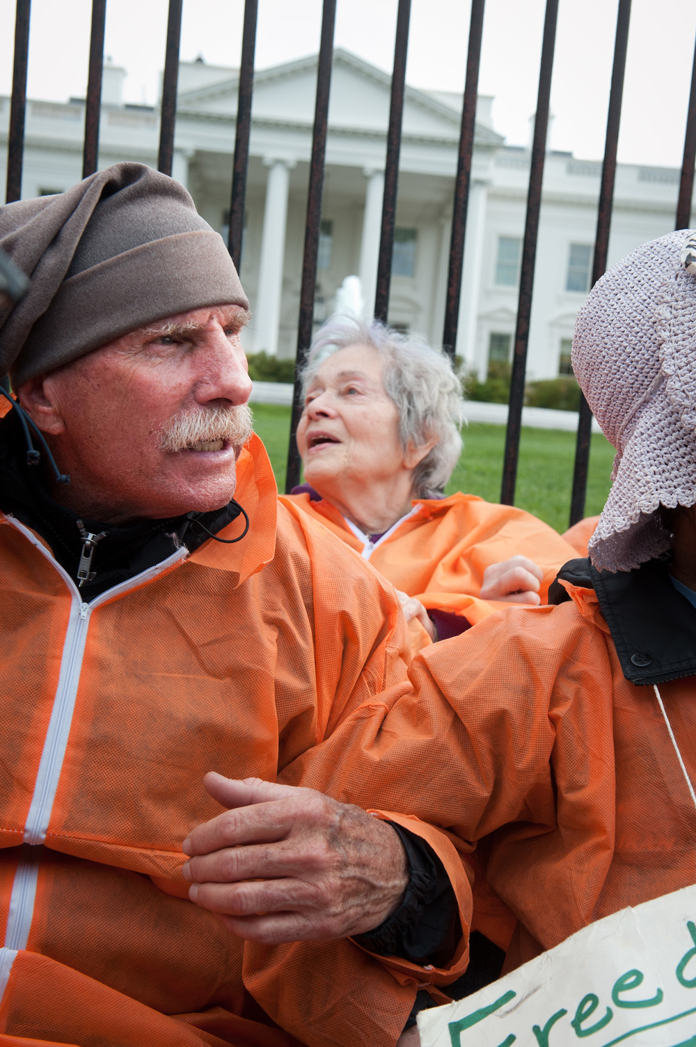 Activists prepare to be arrested in front of the White House. Many being retired, elderly are commonly the ones volunteering for arrestable civil disobedience actions. (Apriul 24th, 2012)