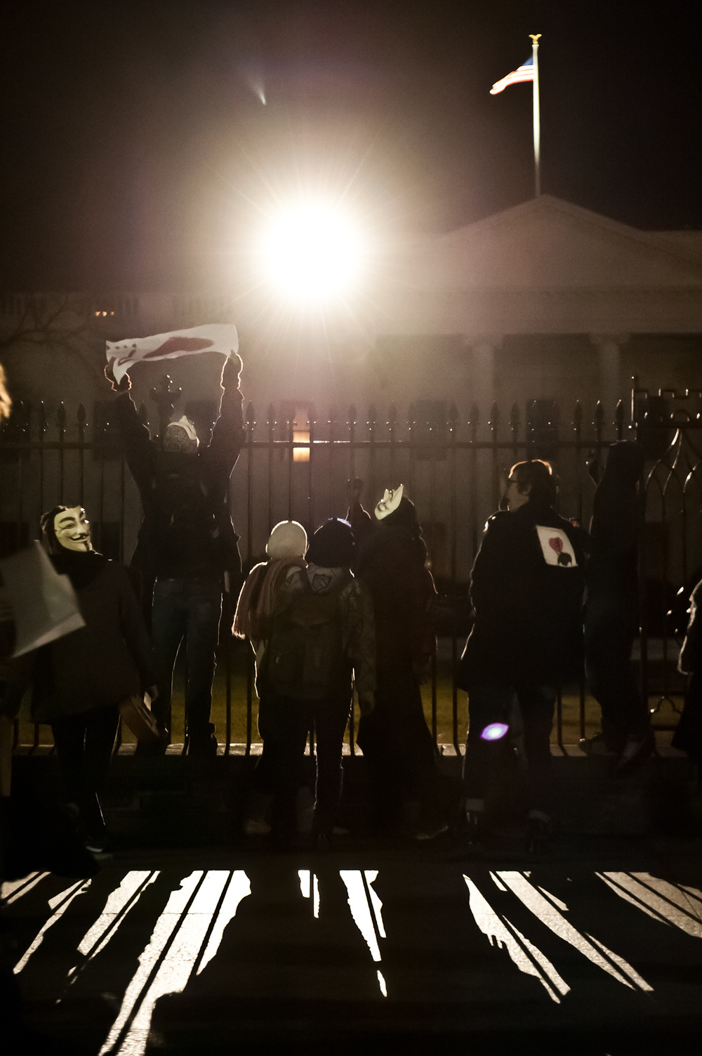 """Members of the 4chan originated group """"Anonymous"""" protest the 2012 National Defense Authorization Act in front of the White House. (January 20th, 2012)"""