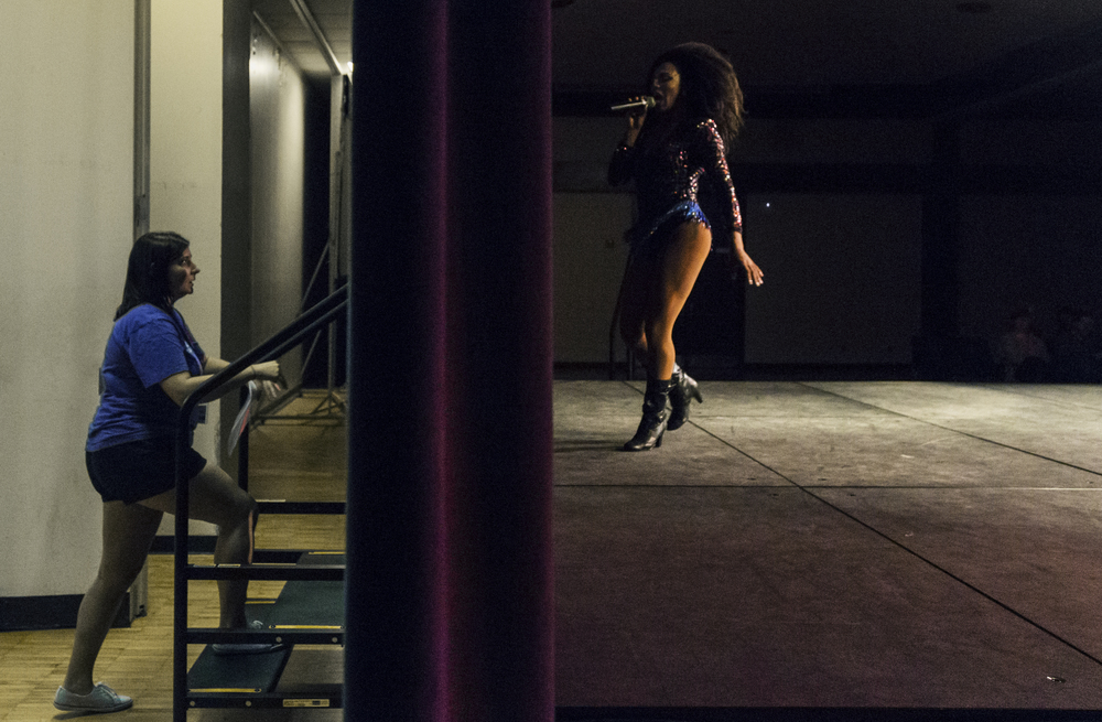 "Shangela Laquifa Wadley, a drag queen and television personality, performs at the ""Guys & Dolls"" drag show while a volunteer watches from backstage at the University of Nebraska-Lincoln in Lincoln, Nebraska."