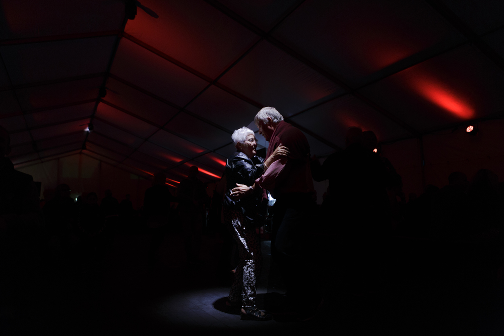 A couple dances to traditional German music under a Biergarten tent during the Aarhus Festuge, a ten-day arts and culture festival in Aarhus, Denmark.