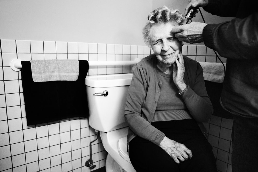 Eloise's caretaker curls her hair at least once a week. Since moving into the assisted-living facility, Eloise now rarely styles her own hair or showers on her own. Still, she remembers her favorite hairstyle, the pageboy, which she had in college.