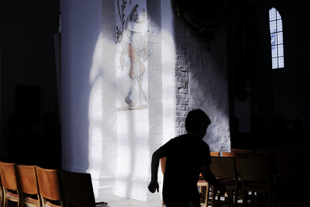 A young boy runs through the Aarhus Cathedral one afternoon in Aarhus, Denmark.