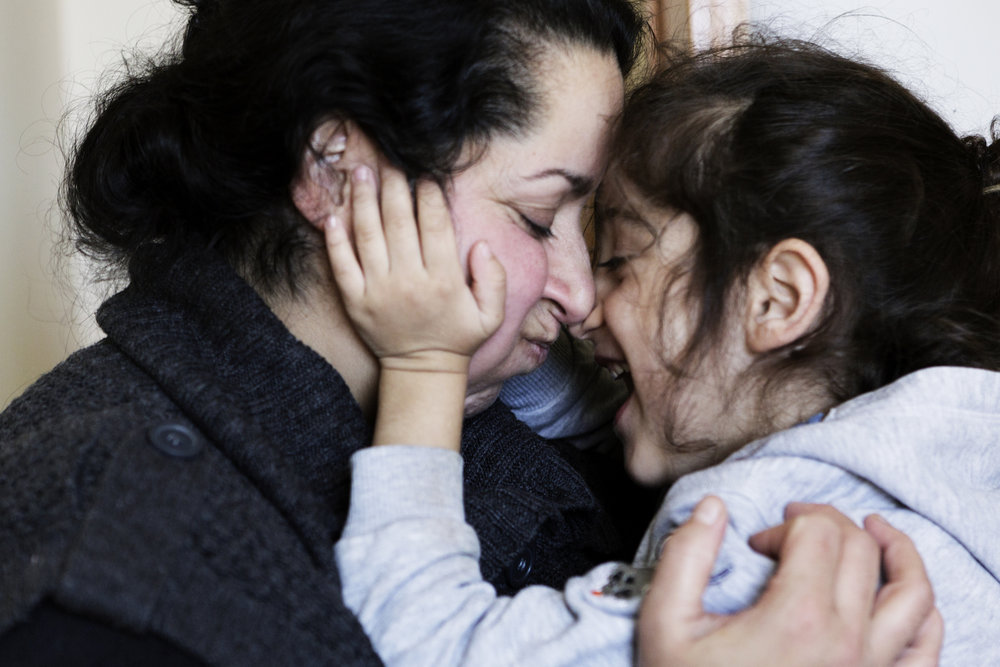 Daliah Omar, Hatab's wife, embraces Moris one afternoon in the family's home.