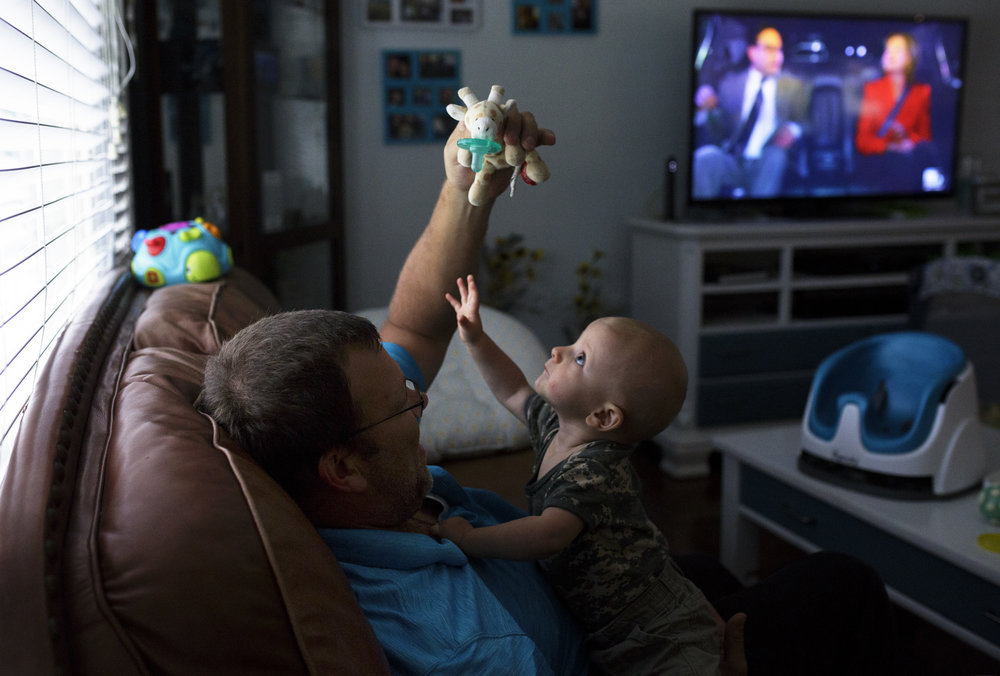 Aric Naas plays with his son, Noah, at their home in Chesapeake, Virginia. On August, 29, 2016, Naas's wife, Carrie, passed away suddenly while in labor to give birth birth to their son.