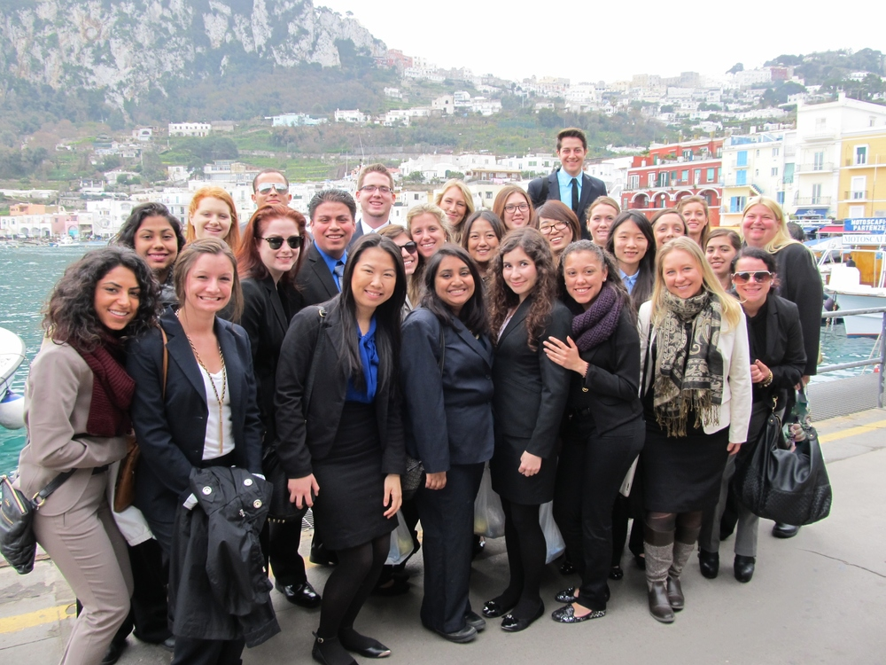 JWU faculty and staff members with students in Italian harbor