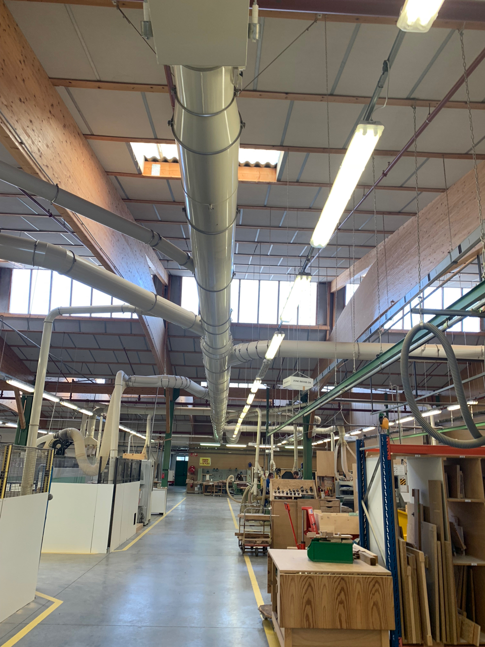 Despite numerous saws and sanders, floors in the carpentry area are saw-dust free. A complex network of tubes connected to high-power vacuums suction any waste to a central location to be compressed and burned for heat in cold seasons.