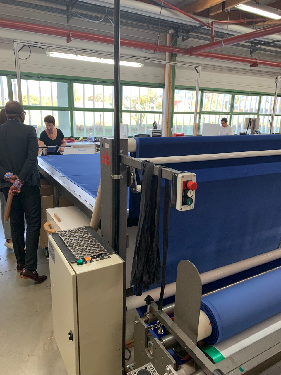 Each bolt of fabric is unrolled and hand-inspected