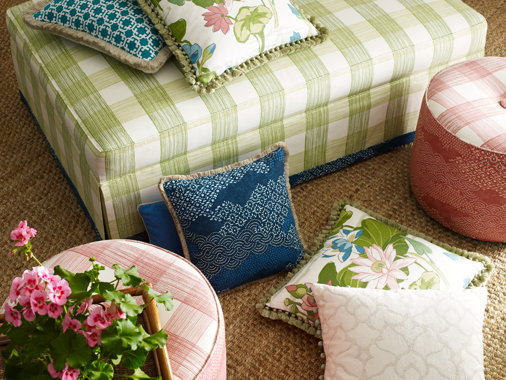 Our celery-hued Georgica Pond, a hand-drawn over-scale check, gives the ottoman, top, a classic American spin. Pillows include Cotton House, Lake Agawam, Blenheim, a beautiful pre-washed cotton damask, and Monserrat, a reversible lattice-inspired geometric.