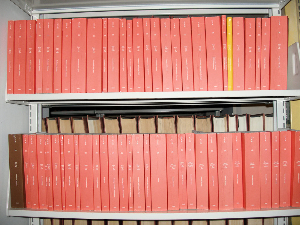 Some of the many volumes of the Code of Federal Regulations.