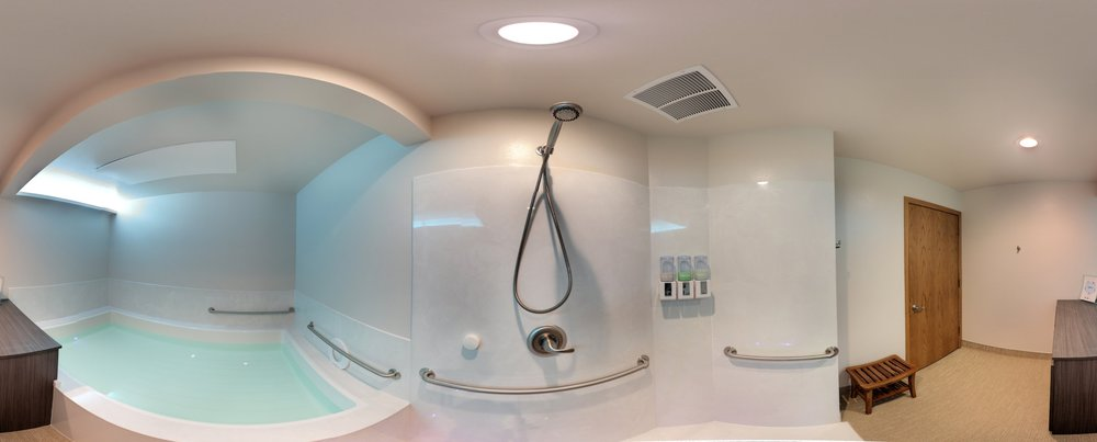 Our ADA/ANSI compliant open float room using cultured marble for surround and shower, and Takiron Pathways flooring.