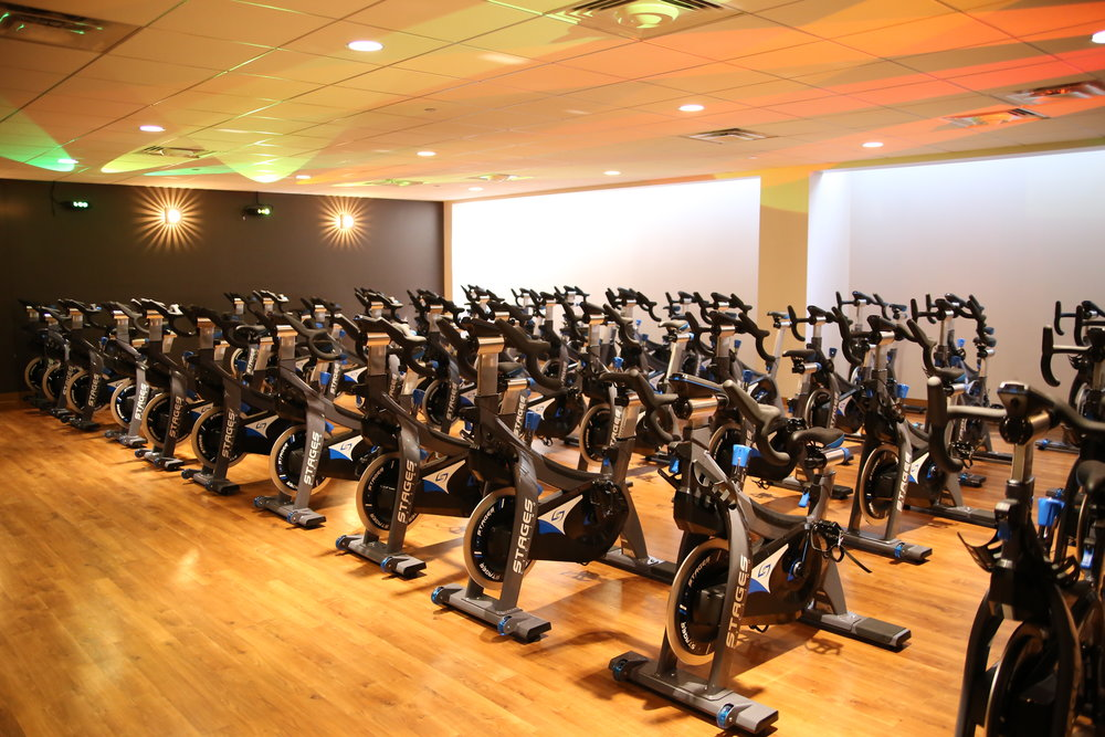 Virtual and instructor led cycle classes are conveniently offered morning, afternoon and evening in the newly renovated  Cycle Studio .