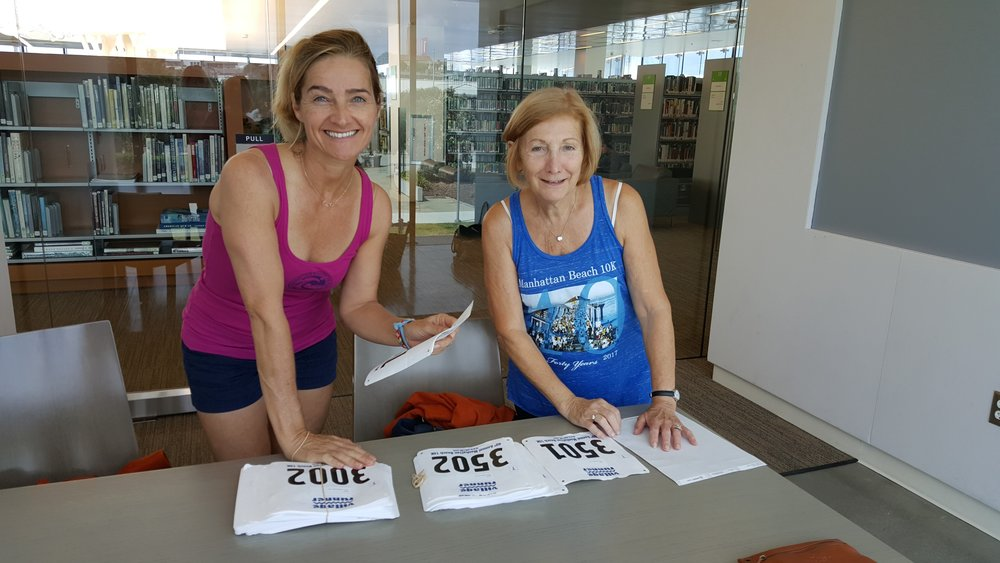 Annamarie and Linda working on the race bibs.