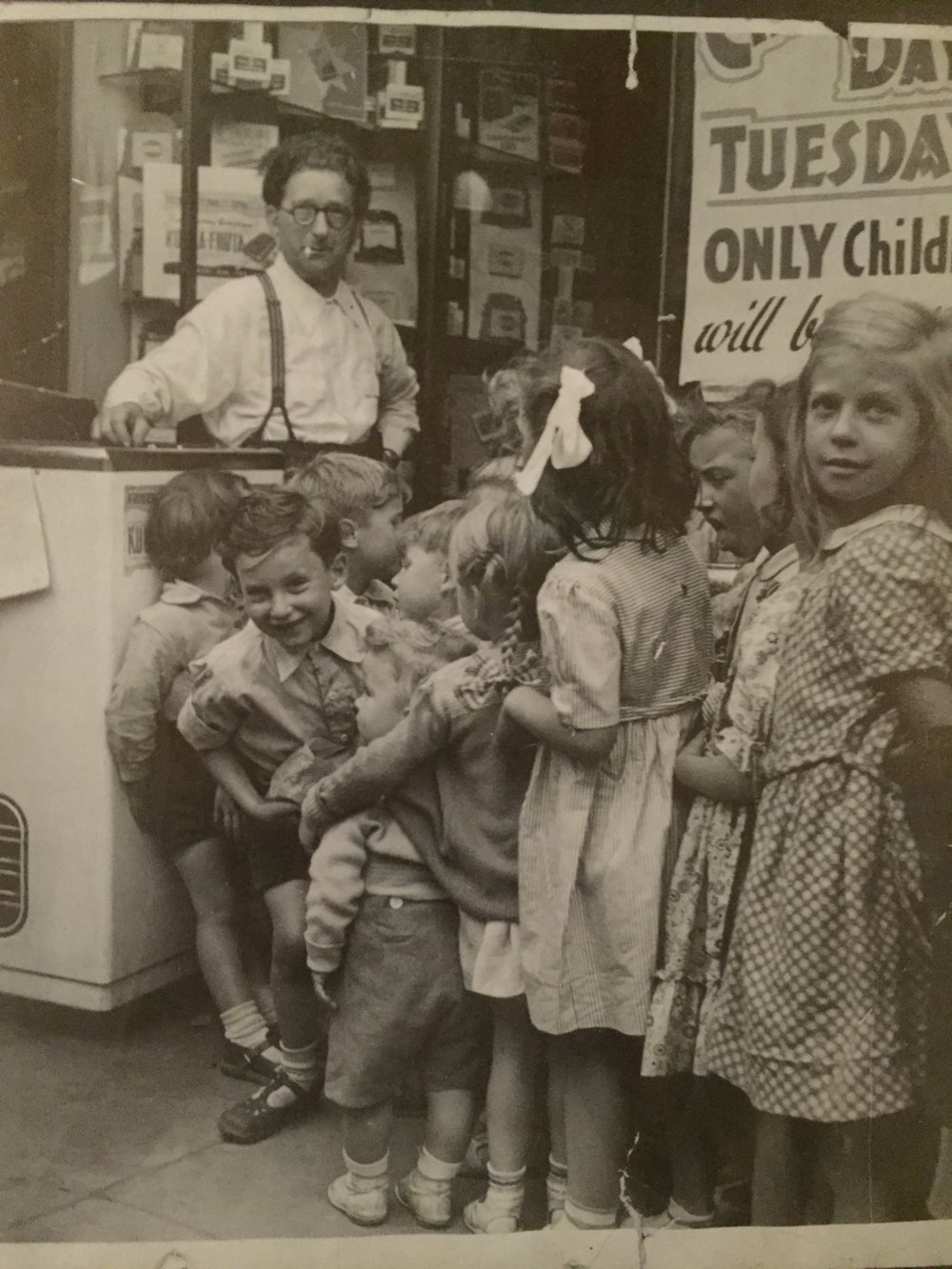 Colin Greer, left front, with his father at the family candy store