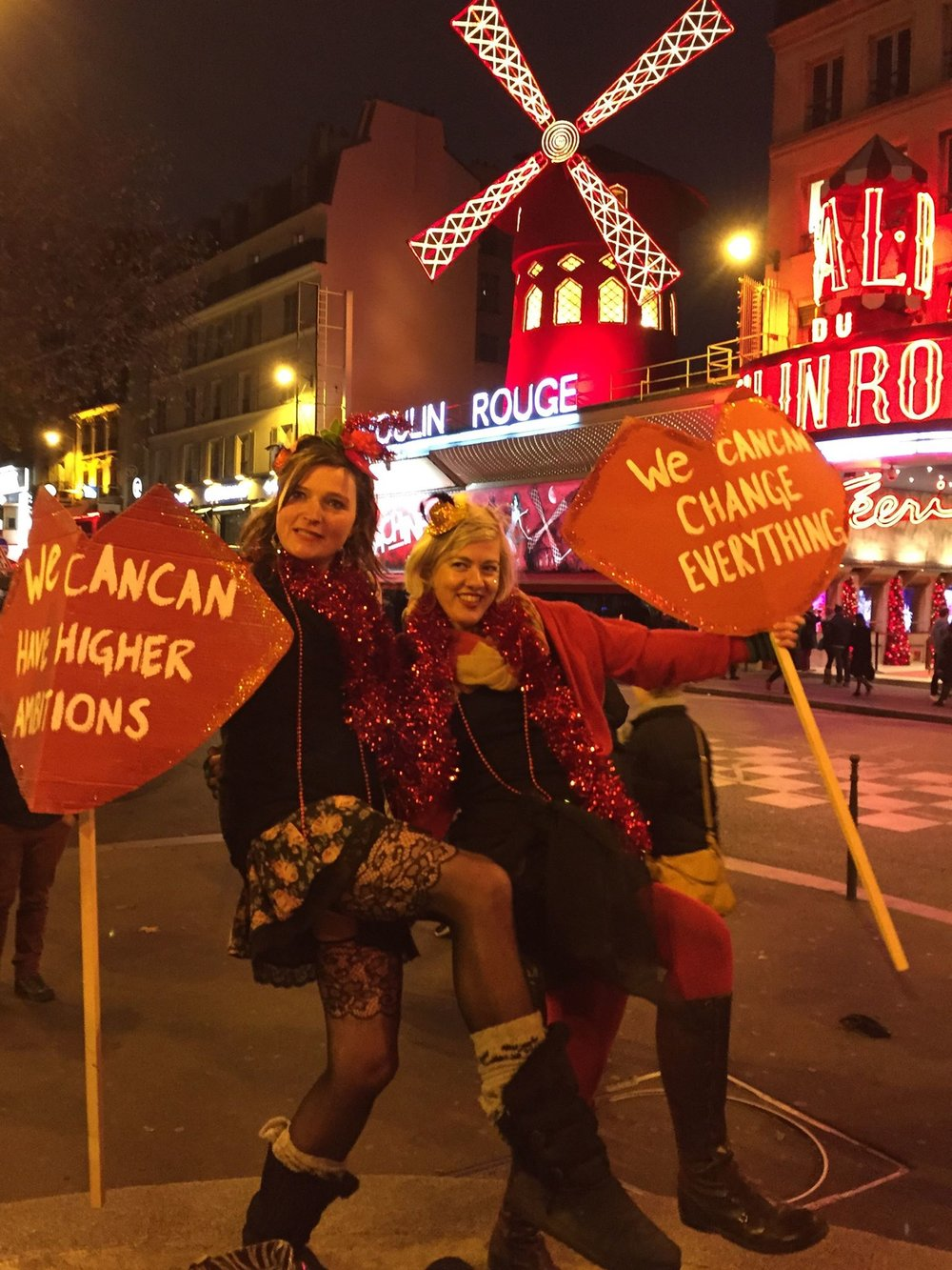 Alex Kelly at the We CanCan action at Moulin Rouge, Paris, during COP21 climate conference, Dec 2015