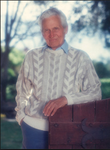 Evarts Loomis standing at the gate of Meadowlark, his medical healing retreat in Hemet, CA