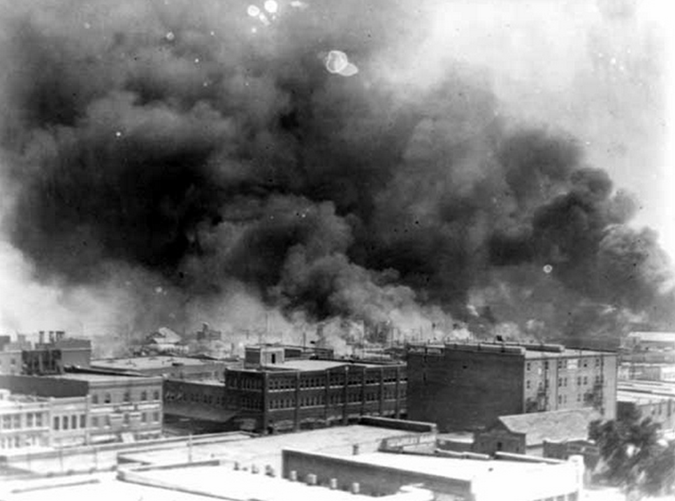 Smoke billowing over Tulsa, Oklahoma, during 1921 race riots  Photo by  Alvin C. Krupnick Co .