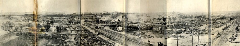 Taken from the southeast corner of the roof of Booker T. Washington High School, this panorama shows much of the damage within a day or so of the riot and the burning.  Source