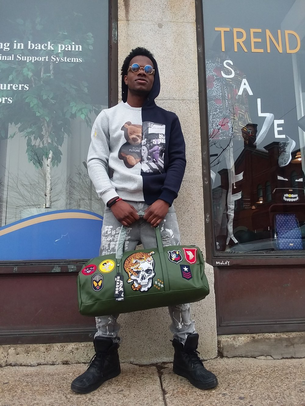 Half and Half Bear Hoodie by Bear the Beams  Ice Graffiti Distressed Denim by Seize&Desist  Travel Bag by Reason NYC  Model: Jeremiah Austin   Styled and Photo by Giovanni Centurione