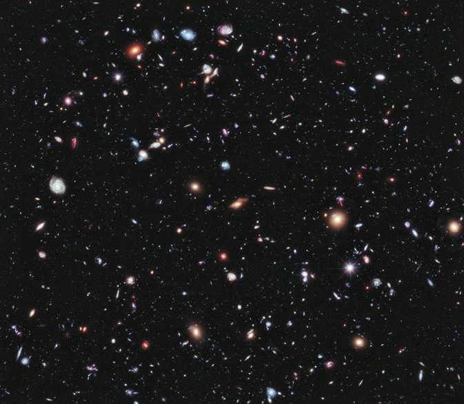 Like photographers assembling a portfolio of best shots, astronomers have assembled a new, improved portrait of mankind's deepest-ever view of the universe. Called the eXtreme Deep Field, or XDF, the photo was assembled by combining 10 years of NASA Hubble Space Telescope photographs taken of a patch of sky at the center of the original Hubble Ultra Deep Field. The XDF is a small fraction of the angular diameter of the full Moon. The Hubble Ultra Deep Field is an image of a small area of space in the constellation Fornax, created using Hubble Space Telescope data from 2003 and 2004. By collecting faint light over many hours of observation, it revealed thousands of galaxies, both nearby and very distant, making it the deepest image of the universe ever taken at that time. The new full-color XDF image reaches much fainter galaxies, and includes very deep exposures in red light from Hubble's new infrared camera, enabling new studies of the earliest galaxies in the universe. The XDF contains about 5,500 galaxies even within its smaller field of view. The faintest galaxies are one ten-billionth the brightness of what the human eye can see. Image Credit: NASA, ESA, G. Illingworth, D. Magee, and P. Oesch (University of California, Santa Cruz), R. Bouwens (Leiden University), and the HUDF09 Team