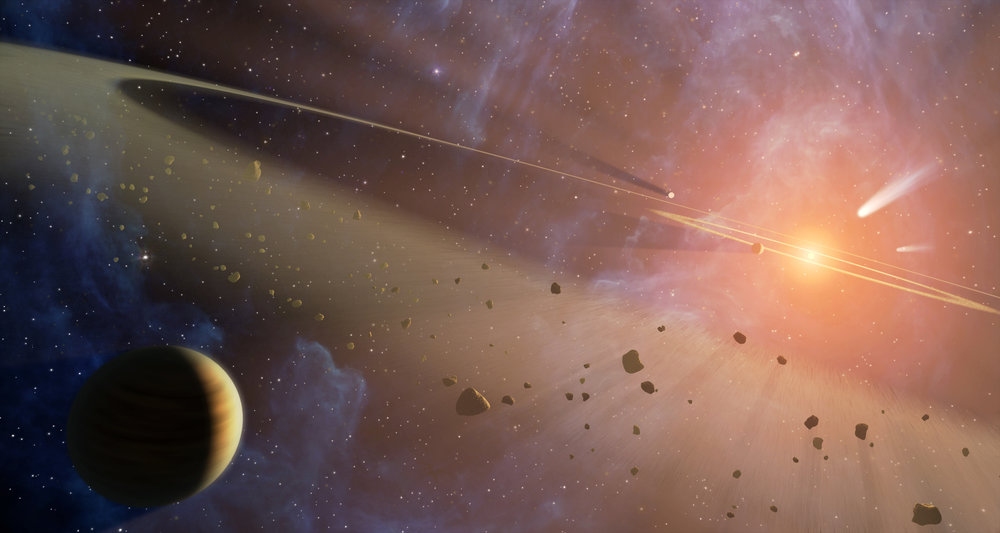 This artist's conception shows the closest known planetary system to our own, called Epsilon Eridani. Observations from NASA's Spitzer Space Telescope show that the system hosts two asteroid belts, in addition to previously identified candidate planets and an outer comet ring. Image credit: NASA/JPL-Caltech