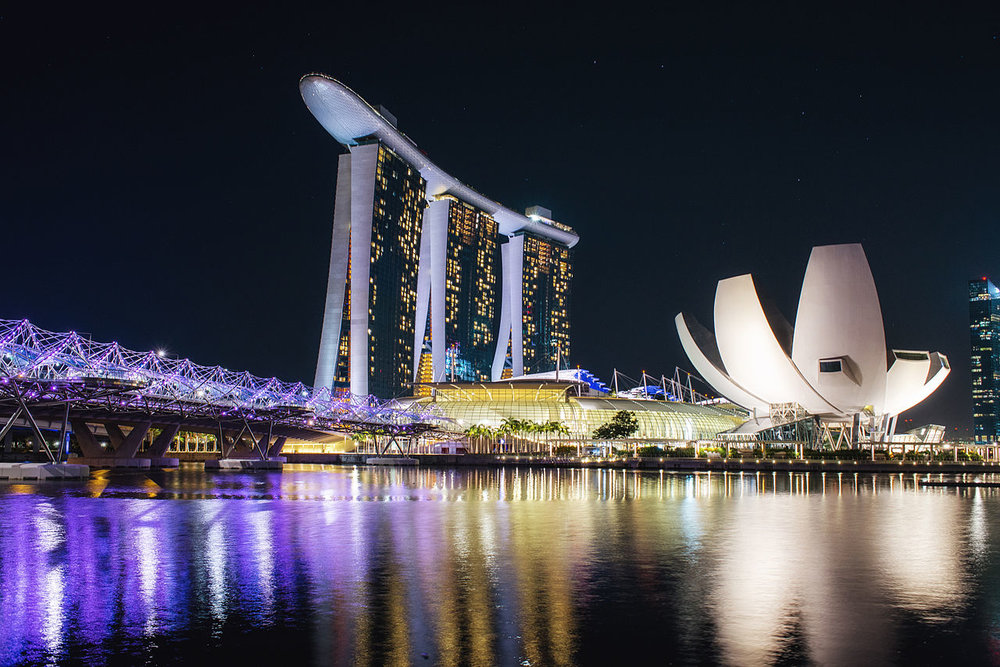 Marina Bay Sands, Singapore, at night. Singapore's light pollution is so severe that the entire population will never use their night vision. Image credit: Leonid iaitskyi, CC A-SA 3.0.