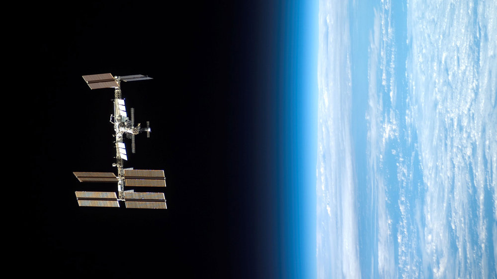 The International Space Station, in orbit around Earth. Image credit: Science@NASA and NASA's Goddard Space Flight Center, International Space Station image courtesy of NASA
