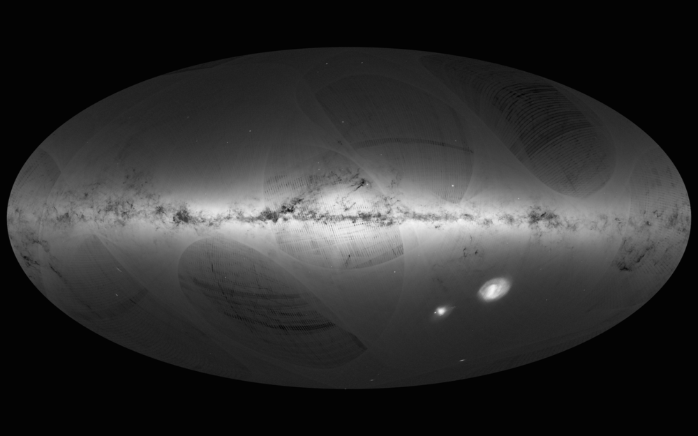 An all-sky view of stars in our Galaxy – the Milky Way – and neighbouring galaxies, based on the first year of observations from ESA's Gaia satellite, from July 2014 to September 2015. This map shows the density of stars observed by Gaia in each portion of the sky. Brighter regions indicate denser concentrations of stars, while darker regions correspond to patches of the sky where fewer stars are observed. The Milky Way is a spiral galaxy, with most of its stars residing in a disc about 100 000 light-years across and about 1000 light-years thick. This structure is visible in the sky as the Galactic Plane – the brightest portion of this image –which runs horizontally and is especially bright at the centre. Image credit: ESA/Gaia/DPAC