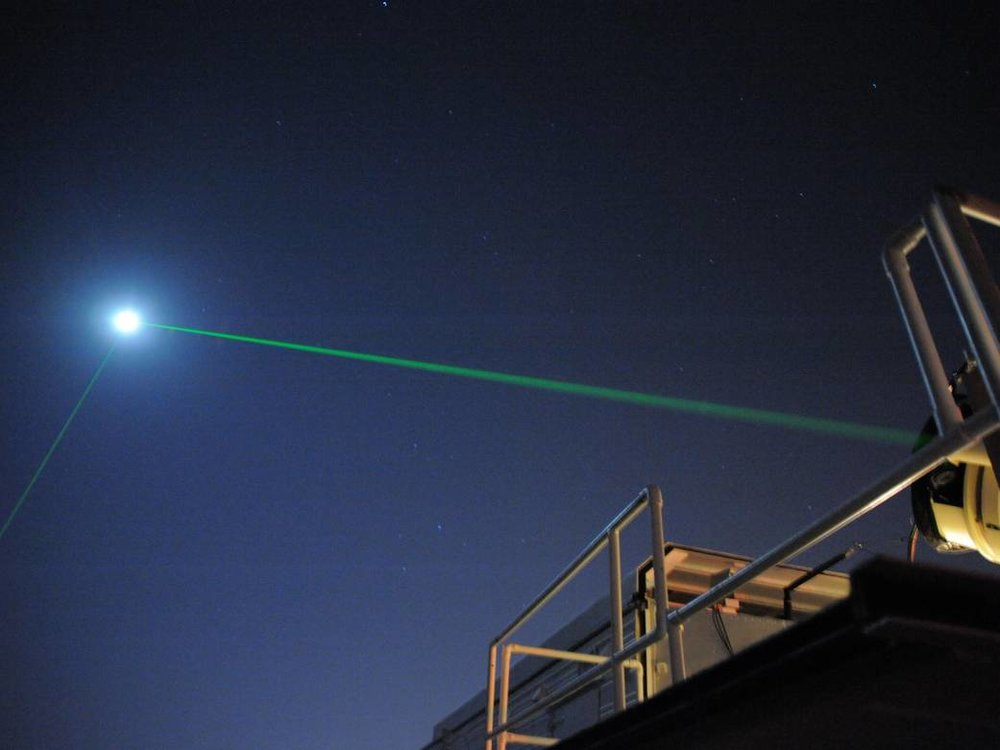 This photograph shows the Laser Ranging Facility at the Geophysical and Astronomical Observatory at NASA's Goddard Space Flight Center in Greenbelt, Md. The observatory helps NASA keep track of orbiting satellites. In this image, the lower of the two green beams is from the Lunar Reconnaissance Orbiter's dedicated tracker. The other laser originates from another ground system at the facility. Both beams are pointed at the moon - specifically at LRO in orbit around the moon. Image Credit: NASA