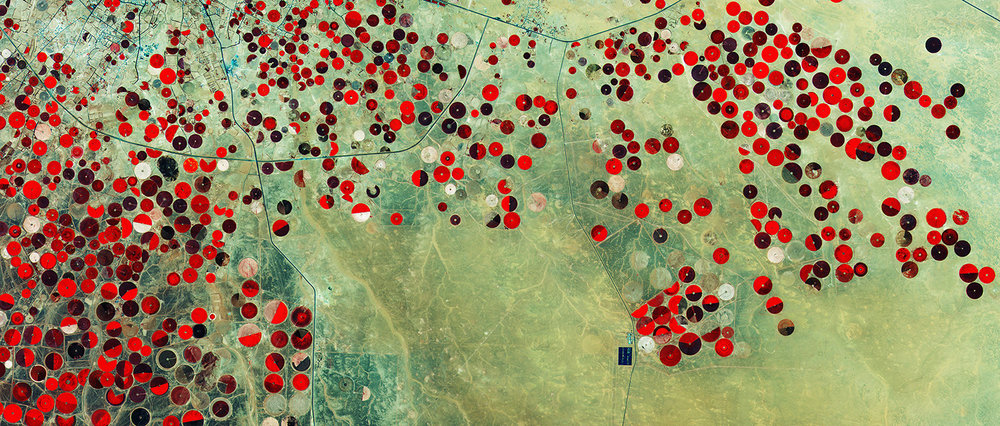 This image from Sentinel-2A shows how Saudi Arabia's desert is being used for agriculture. The circles come from a central-pivot irrigation system, where the long water pipe rotates around a well at the centre. Image Credit: Copernicus Sentinel data (2015)/ESA
