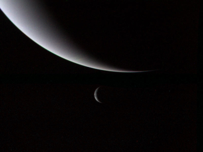 This dramatic view of the crescents of Neptune and Triton was acquired by Voyager 2 approximately 3 days, 6 and one-half hours after its closest approach to Neptune (north is to the right). The spacecraft is now plunging southward at an angle of 48 degrees to the plane of the ecliptic. This direction, combined with the current season of southern summer in the Neptune system, gives this picture its unique geometry. Image credit: NASA/JPL