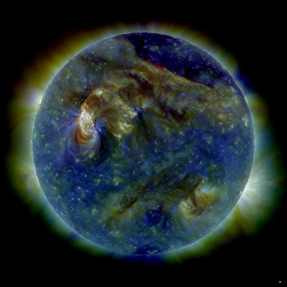On August 1st, almost the entire Earth-facing side of the sun erupted in a tumult of activity. There was a C3-class solar flare (white area on upper left), a solar tsunami (wave-like structure, upper right), multiple filaments of magnetism lifting off the stellar surface, large-scale shaking of the solar corona, radio bursts, a coronal mass ejection and more. This multi-wavelength (211, 193 & 171 Angstrom) extreme ultraviolet snapshot from the Solar Dynamics Observatory (SDO) shows the sun's northern hemisphere in mid-eruption. Different colors in the image represent different gas temperatures ranging from ~1 to 2 million degrees K.  Credit: NASA/SDO/AIA