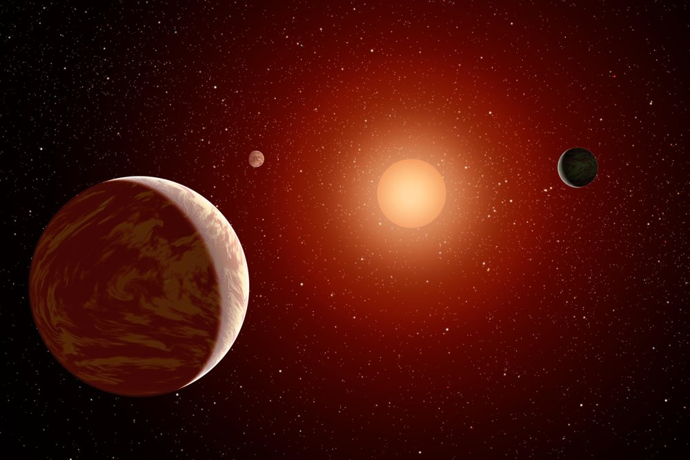 This artist's concept illustrates a young, red dwarf star surrounded by three planets. Such stars are dimmer and smaller than yellow stars like our sun, which makes them ideal targets for astronomers wishing to take images of planets outside our solar system, called exoplanets. NASA's Galaxy Evolution Explorer is helping to identify young, red dwarf stars that are close to us by detecting their ultraviolet light (stars give off a lot of ultraviolet light in their youth). Image Credit: NASA/JPL-Caltech