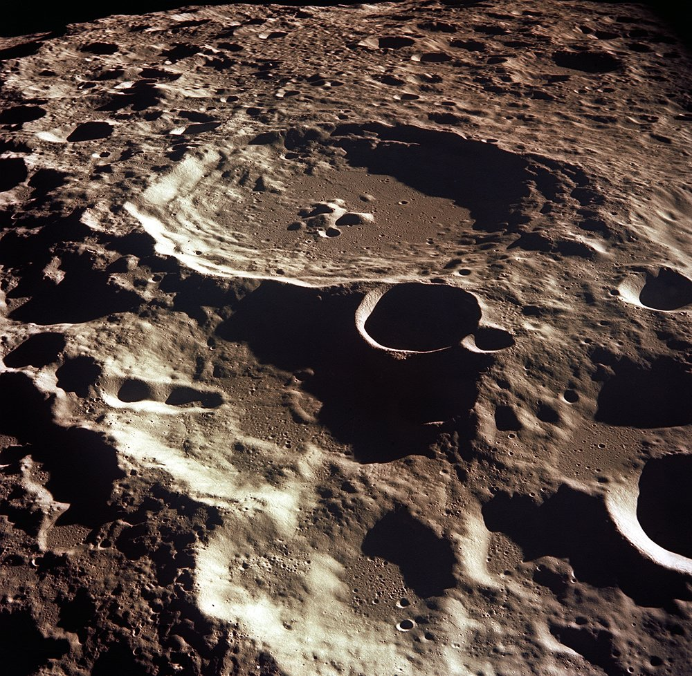 An oblique view of the Crater Daedalus on the lunar farside as seen from the Apollo 11 spacecraft in lunar orbit. Daedalus (formerly referred to as Crater No. 308) is has a diameter of about 50 miles. This is a typical scene showing the rugged terrain on the farside of the moon. Image credit: NASA
