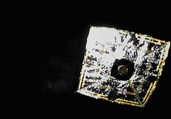 "The Japan Aerospace Exploration Agency (JAXA) successfully took images of the whole solar sail of the Small Solar Power Sail Demonstrator ""IKAROS"" after its deployment of a separation camera* on June 15 (Japan Standard Time, JST.) The IKAROS was launched on May 21, 2010 (JST) from the Tanegashima Space Center. Image credit: JAXA"