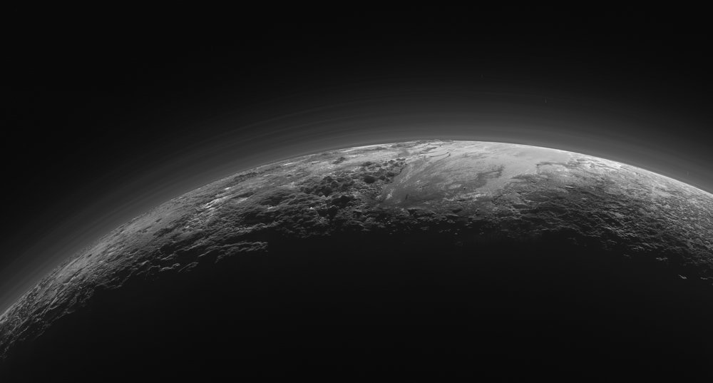 Plutonian landscapes in twilight, under a hazy sky. Credit: NASA/JHU APL/SwRI