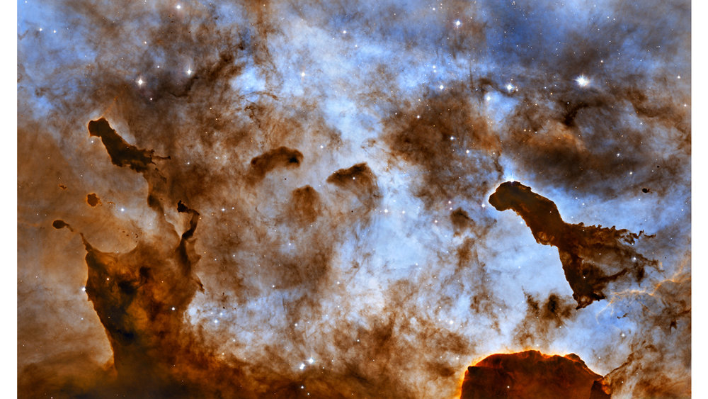 These one-light-year-tall pillars of cold hydrogen and dust, imaged by the Hubble Space Telescope, are located in the Carina Nebula. This image of dust pillars in the Carina Nebula is a composite of 2005 observations taken of the region in hydrogen light (light emitted by hydrogen atoms) along with 2010 observations taken in oxygen light (light emitted by oxygen atoms), both times with Hubble's Advanced Camera for Surveys. The immense Carina Nebula is an estimated 7,500 light-years away in the southern constellation Carina. NASA, ESA, and the Hubble Heritage Project (STScI/AURA); Acknowledgment: M. Livio (STScI) and N. Smith (University of California, Berkeley)