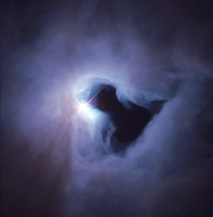 NGC 1999 is an example of a reflection nebula. Like fog around a street lamp, a reflection nebula shines only because the light from an embedded source illuminates its dust; the nebula does not emit any visible light of its own. NGC 1999 lies close to the famous Orion Nebula, about 1,500 light-years from Earth, in a region of our Milky Way galaxy where new stars are being formed actively.  Image Credit: NASA and The Hubble Heritage Team (STScI)