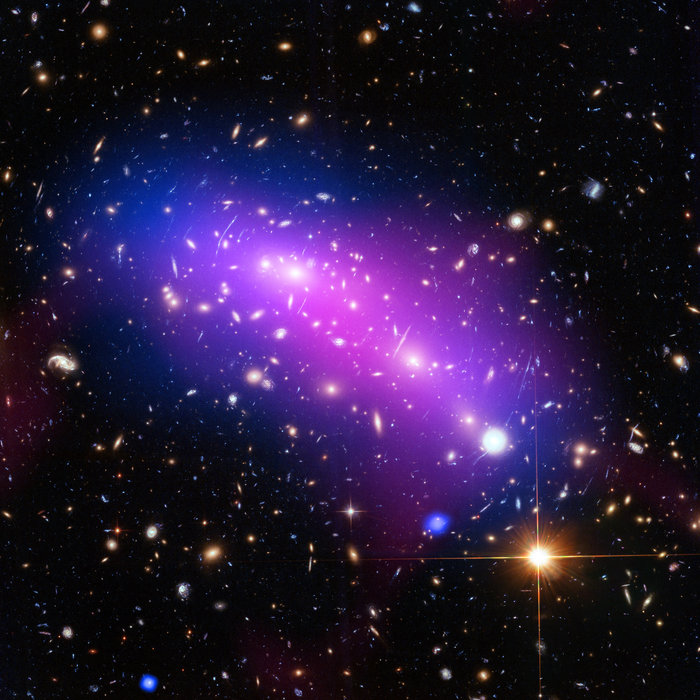 At first glance, this cosmic kaleidoscope of purple, blue and pink offers a strikingly beautiful — and serene — snapshot of the cosmos. However, this multi-coloured haze actually marks the site of two colliding galaxy clusters, forming a single object known as MACS J0416.1-2403 (or MACS J0416 for short). Image credit: NASA, ESA, CXC, NRAO/AUI/NSF, STScI, and G. Ogrean (Stanford University)