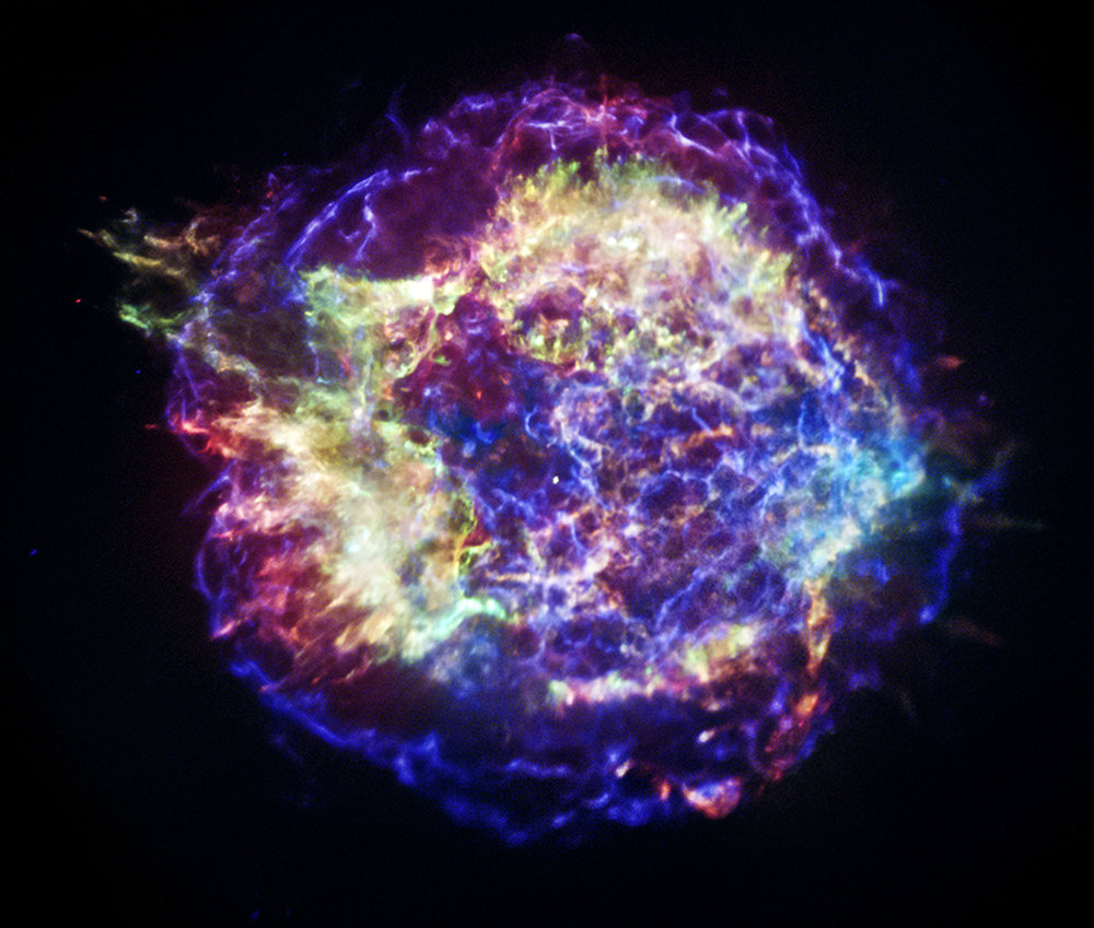 This new version of Chandra's image of the Cassiopeia A supernova remnant has been specially processed to show with better clarity the appearance of Cas A in different bands of X-rays. This will aid astronomers in their efforts to reconstruct details of the supernova process such as the size of the star, its chemical makeup, and the explosion mechanism. The color scheme used in this image is the following: low-energy X-rays are red, medium-energy ones are green, and the highest-energy X-rays detected by Chandra are colored blue. Image Credit: NASA/CXC/SAO.