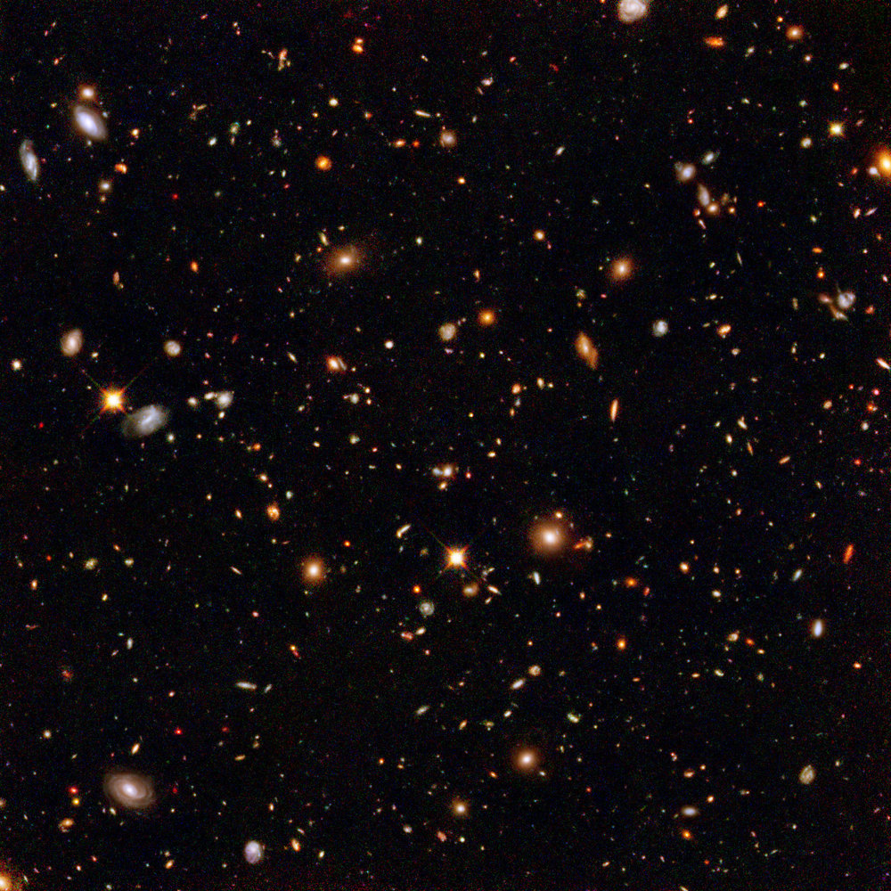 This infrared view reveals galaxies far, far away that existed long, long ago. Taken by the Near Infrared Camera and Multi-Object Spectrometer aboard the NASA/ESA Hubble Space Telescope, the image is part of the Hubble Ultra Deep Field survey, the deepest portrait ever taken of the universe. Image credit: NASA, ESA and R. Thompson (Univ. Arizona)