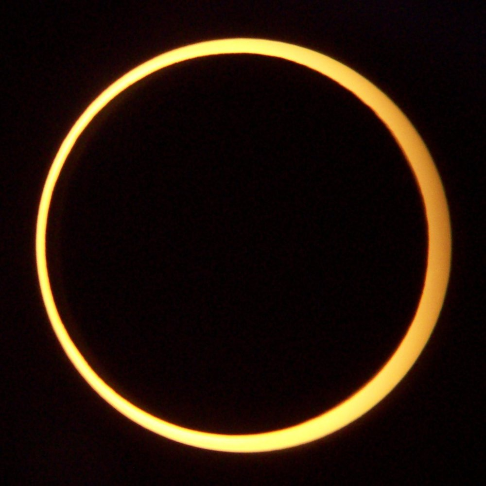 "Annular eclipse. Taken from a 8"" Reflector with a solar filter. Image credit: wikimedia user Smrgeog, CC BY SA 3.0"