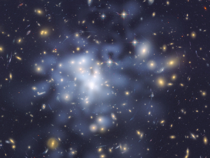 Astronomers using NASA's Hubble Space Telescope took advantage of a giant cosmic magnifying glass to create a detailed map of dark matter in the universe. Image credit: NASA, ESA, and D. Coe (NASA JPL/Caltech and STScI)