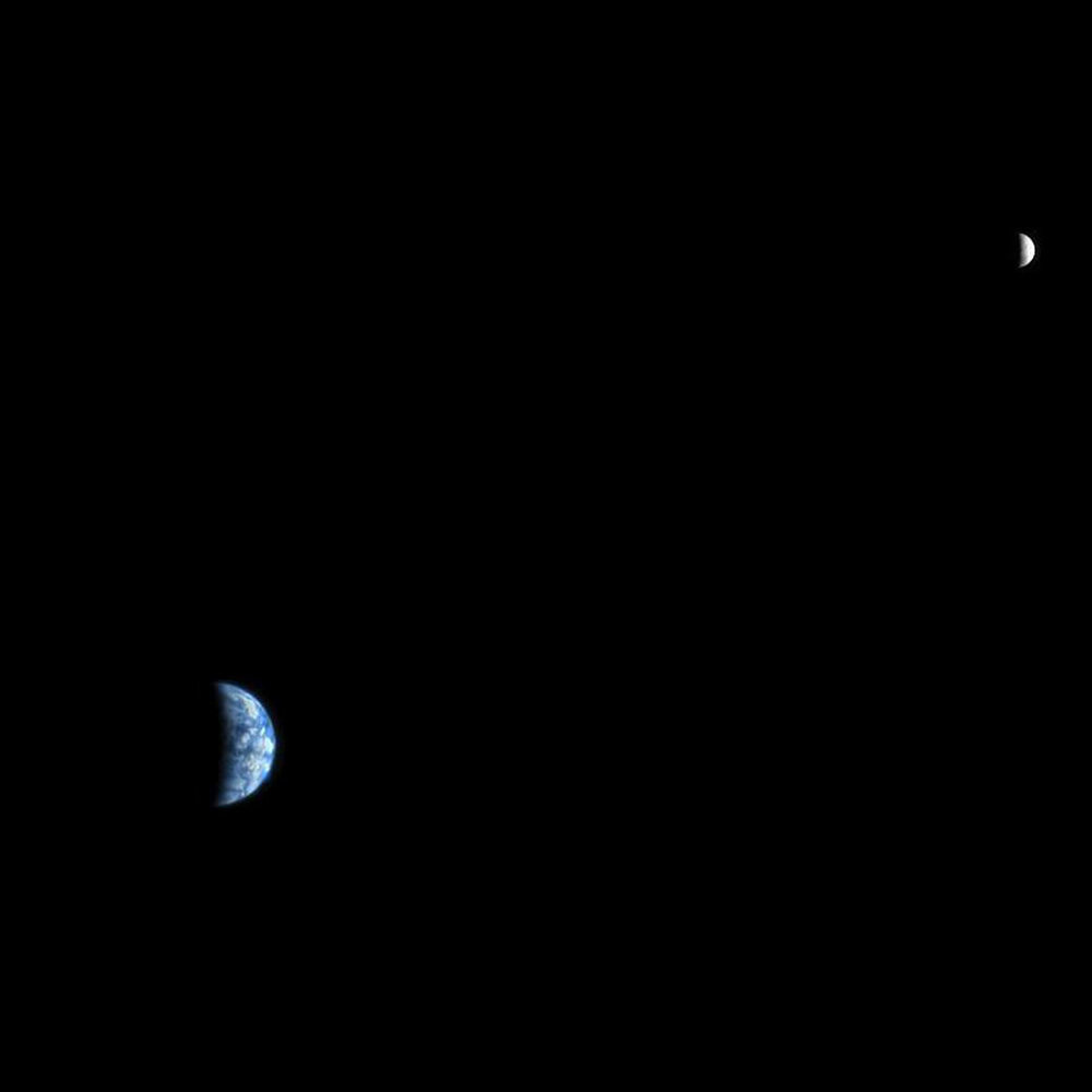 This is an image of Earth and the moon, acquired on October 3, 2007, by the HiRISE camera on NASA's Mars Reconnaissance Orbiter. At the time the image was taken, Earth was 142 million kilometers (88 million miles) from Mars, giving the HiRISE image a scale of 142 kilometers (88 miles) per pixel. The moon image is brightened relative to Earth for this composite. Image credit: NASA/JPL-Caltech/University of Arizona