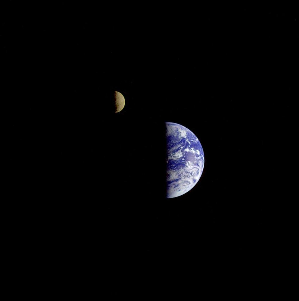 The Galileo spacecraft took this 1992 shot showing the Moon in orbit about Earth. With only a third of the brightness of Earth, the Moon has been digitally enhanced to improve visibility. Image credit: NASA